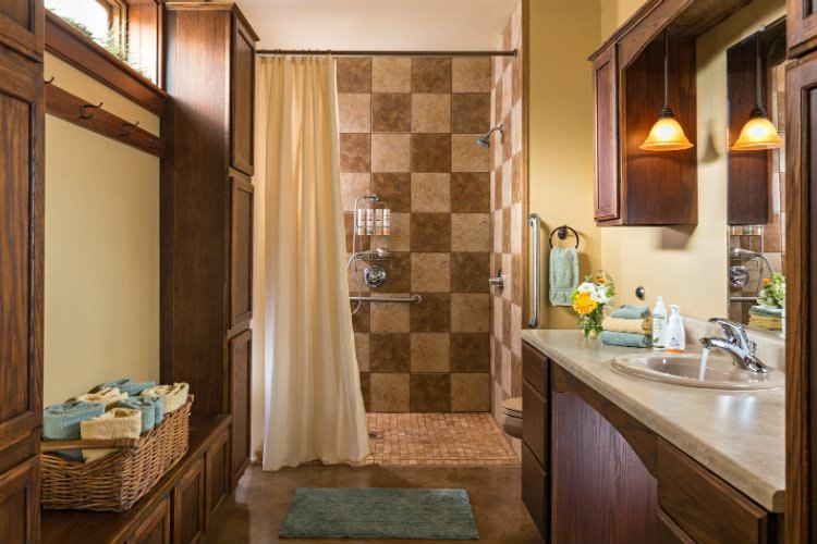 Guest bathroom with a tan tiled walk-in bathroom, a long vanity and gorgeous marble flooring