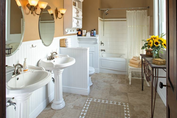 gallery-Guest bathroom with ceramic tiled flooring, two stand alone ceramic sinks, a tub and shower, and tan walls.-4