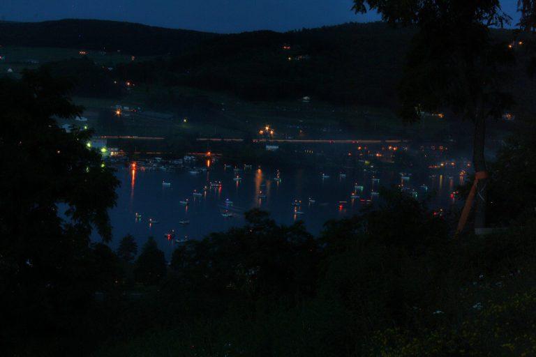 Deep Creek Lake dark night with boats dotting the lakes edge
