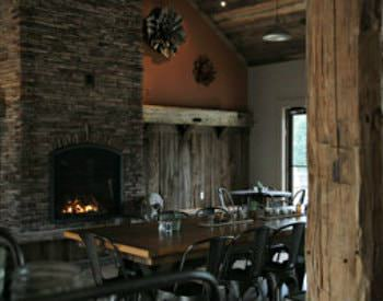 Interior view of the cornucopia café, a brown rustic design with a floor to ceiling stone fireplace.