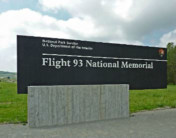 "Exterior black sign which says, ""National park service, U.S. department of the interior, flight 93 national memorial."""